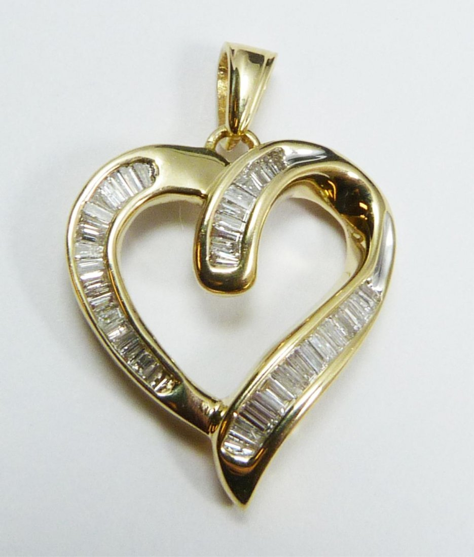 111: 14K YELLOW GOLD DIAMOND HEART PENDANT