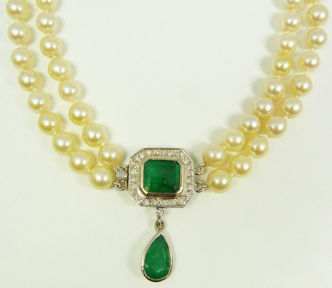 116: 18K WG PEARL NECKLACE WITH 8CTW EMERALDS