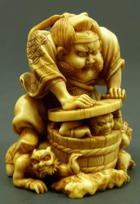 CARVED IVORY STUDY OF WARRIOR TRAPPING ONI