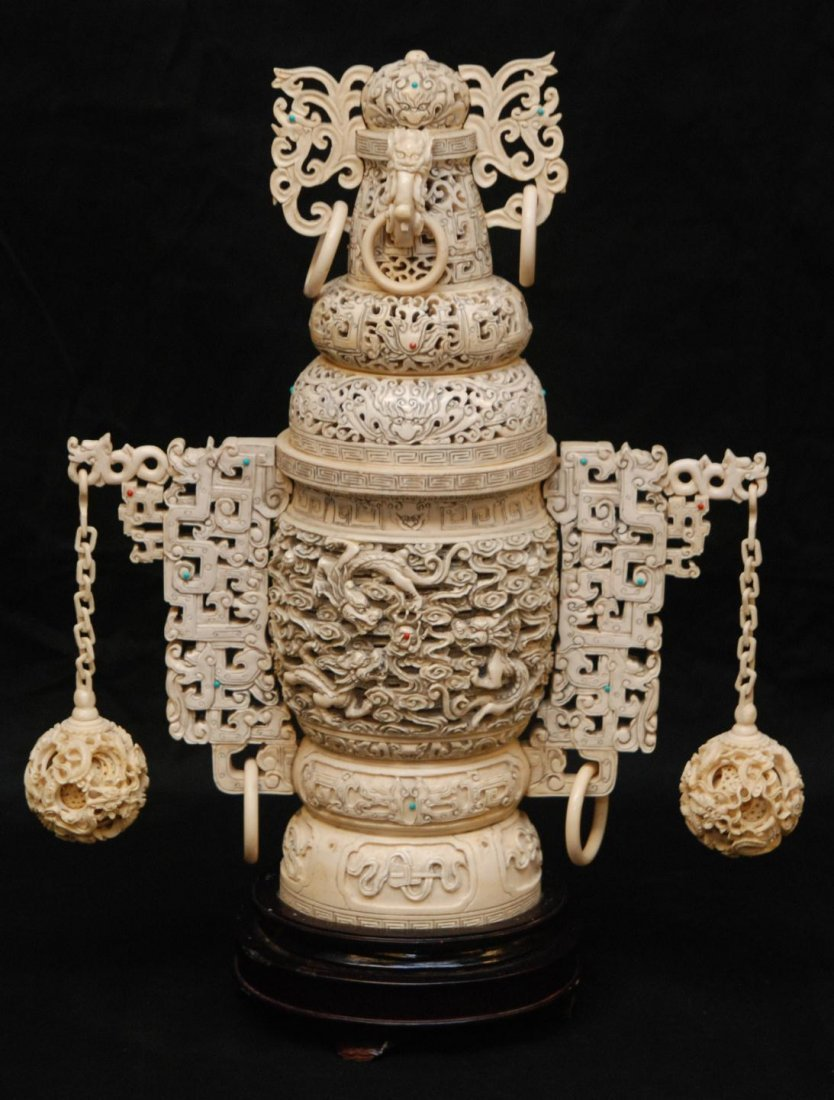 519: CHINESE CARVED IVORY CONCENTRIC DRAGONS URN