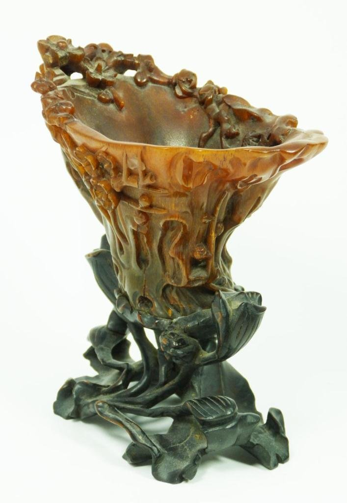 94: CHINESE CARVED RHINOCEROS HORN FLORAL LIBATION CUP