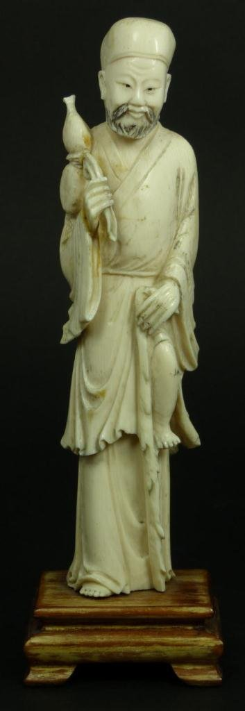 13: CHINESE CARVED IVORY FISHERMAN FIGURE
