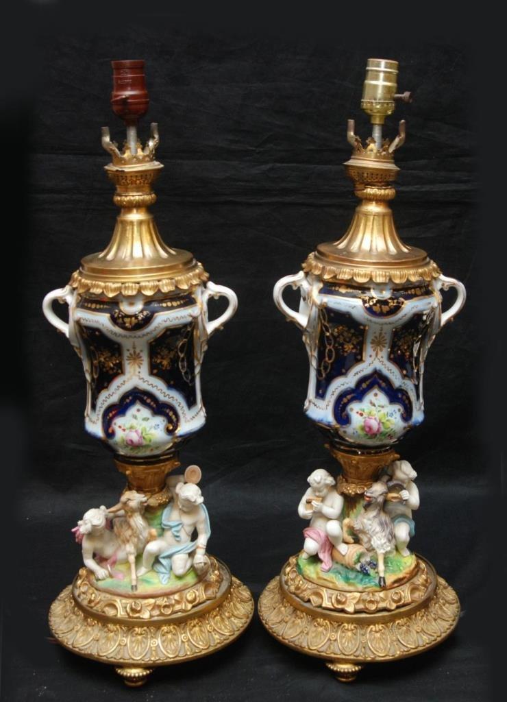 A PAIR OF BOHEMIAN PORCELAIN & GILT GOAT LAMPS