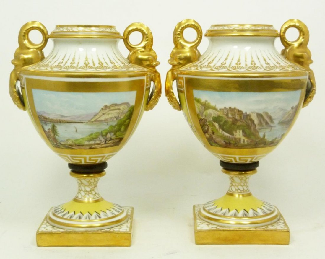 PAIR OF GERMAN HAND PAINTED PORCELAIN FOOTED URNS