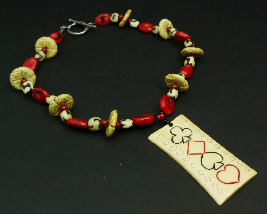 VINTAGE STERLING CORAL AND BONE ETHNIC NECKLACE