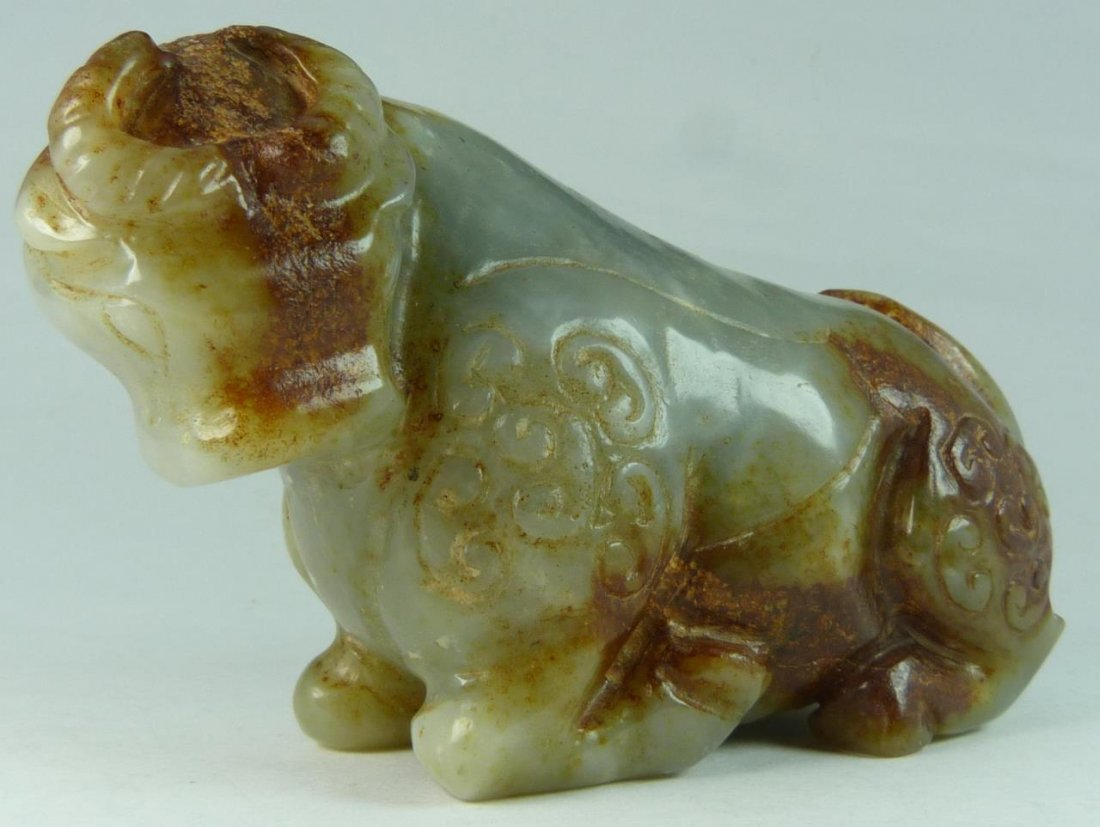 ARCHAIC CHINESE PALE GREEN JADE OX SCULPTURE