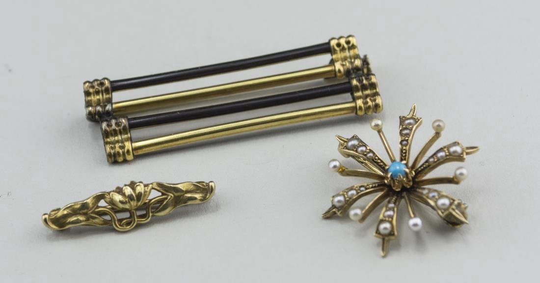 Three Gold Pins