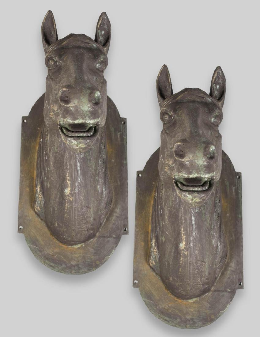 Pair of Cast Iron Horse Heads   *