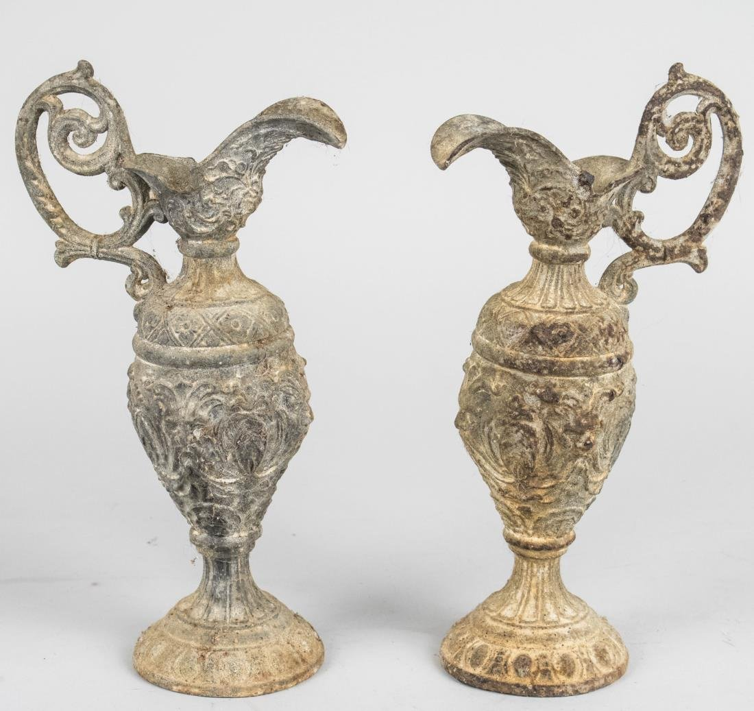 Pair of Iron Ewers