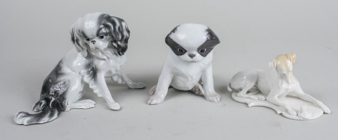 Three Porcelain Figures of Dogs