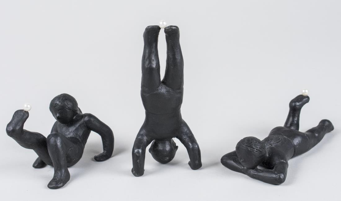 Three Iron Figure Sculptures
