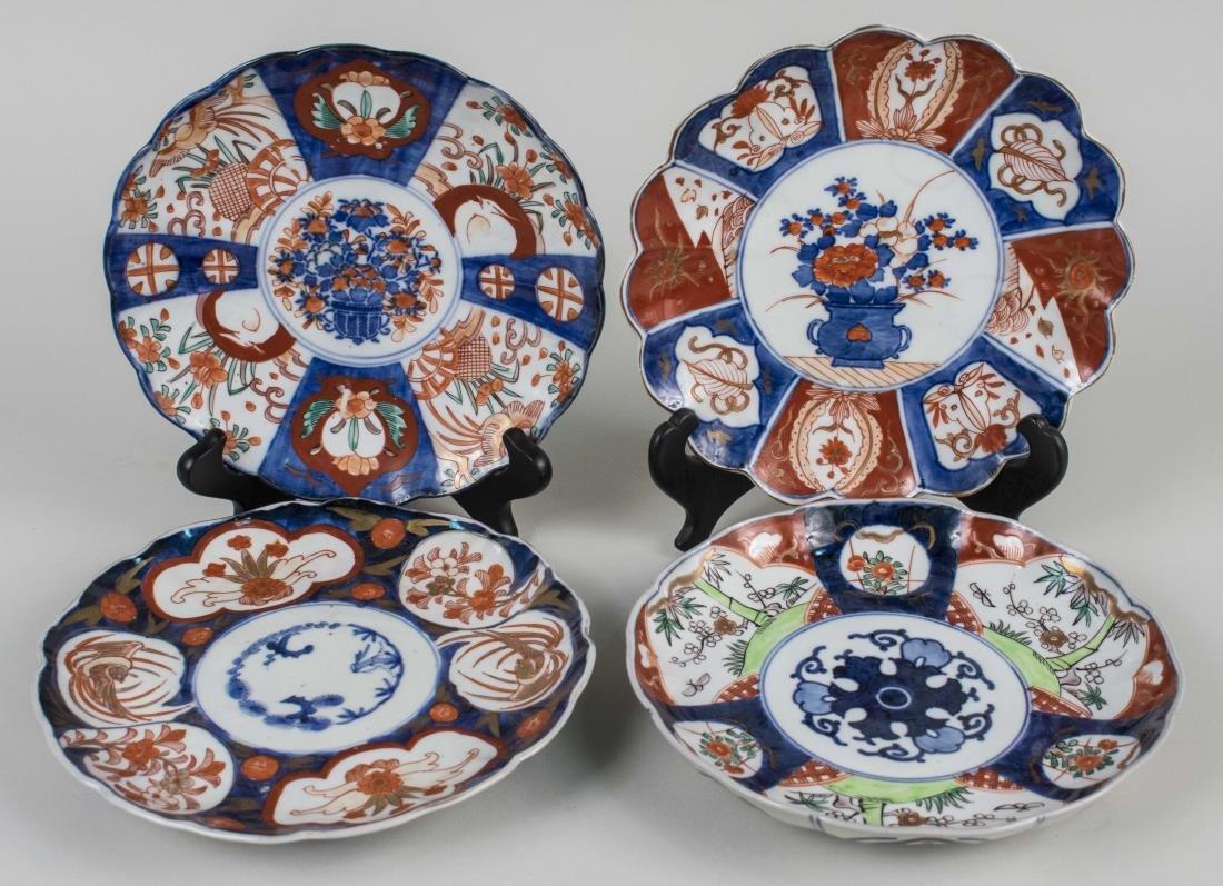 Four Imari Porcelain Plates   *