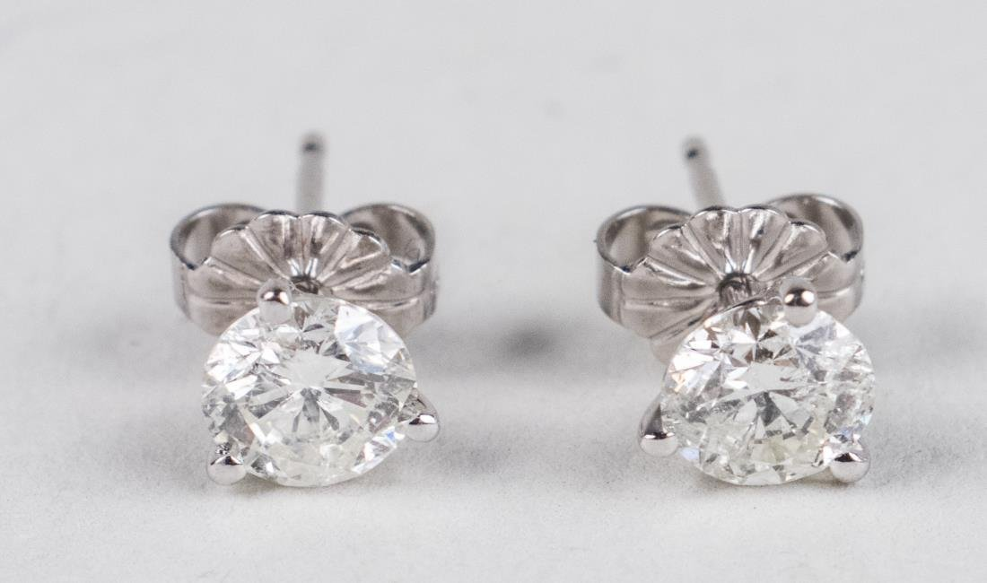 Pair of Diamond Studs   *