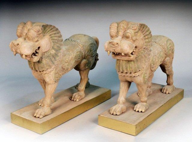 729: Pair of Monumental Carved Wood Foo Lions