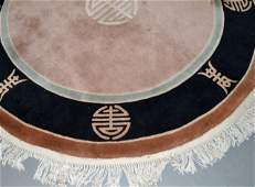 Two Chinese Circular Carved Carpets