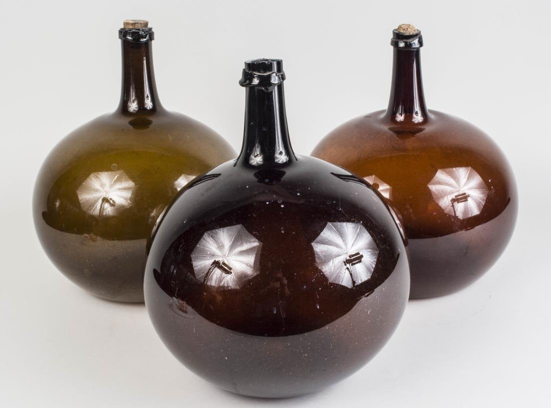 Three Brown Blown Glass Demijohn Bottles