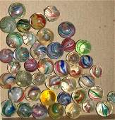 65: Small box of old marbles
