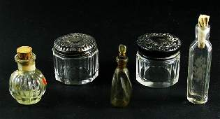 2211: Five perfume bottle/jars