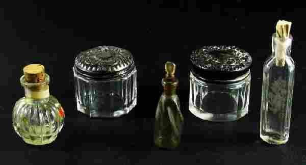 Five perfume bottle/jars
