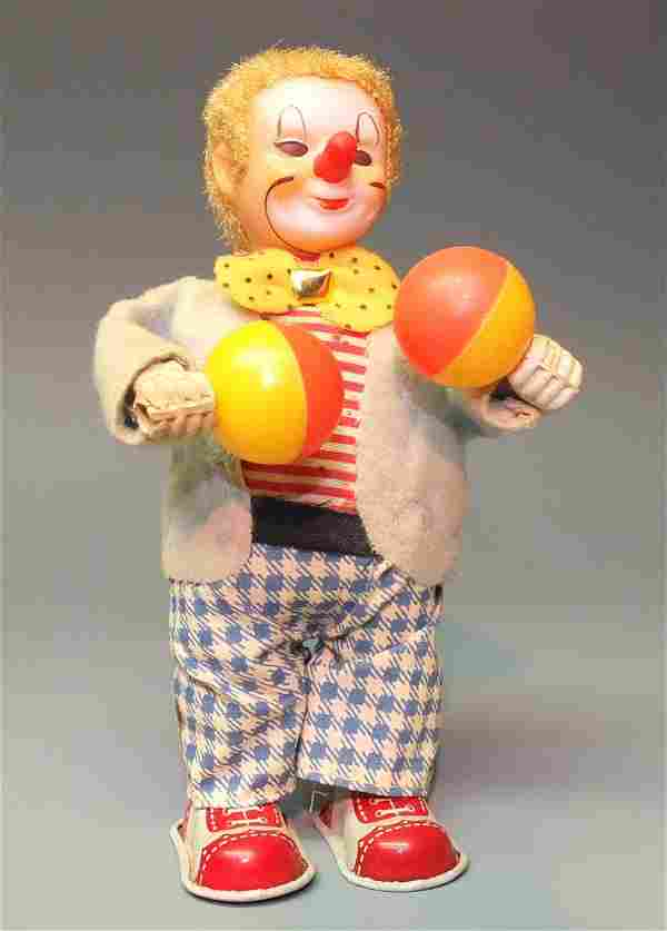 JAPAN WINDUP CLOWN PLAYING WITH BALLS