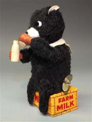 JAPAN OLD FARM MILK DRINKING BEAR TIN WINDUP
