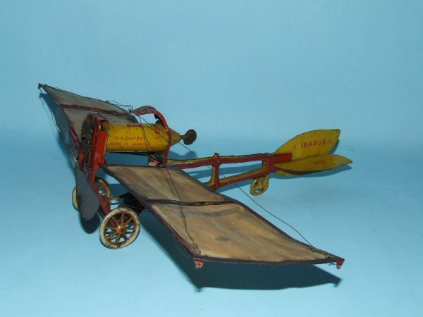 1: LEHMANN IKARUS MECHANICAL TIN WIND UP TOY AIRPLANE