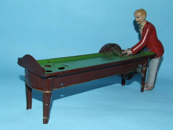7: GUNTHERMANN BILLIARDS POOL PLAYER TIN WIND UP TOY