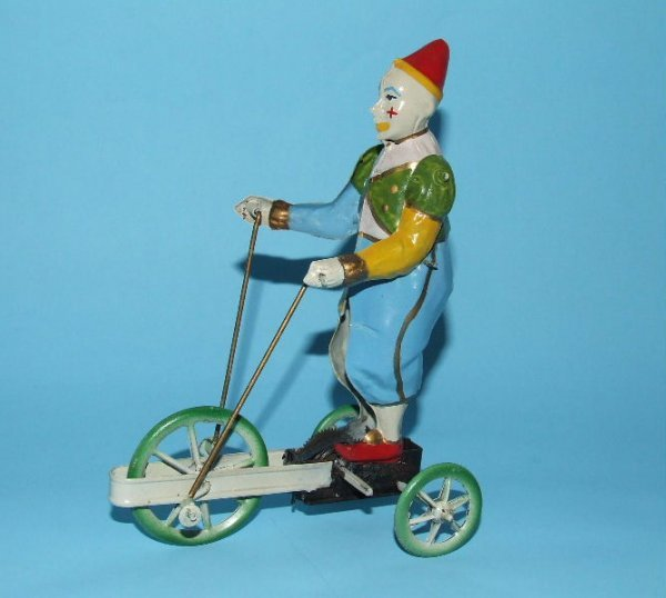 8: GUNTHERMANN CIRCUS CLOWN TRICYCLE TIN WINDUP TOY