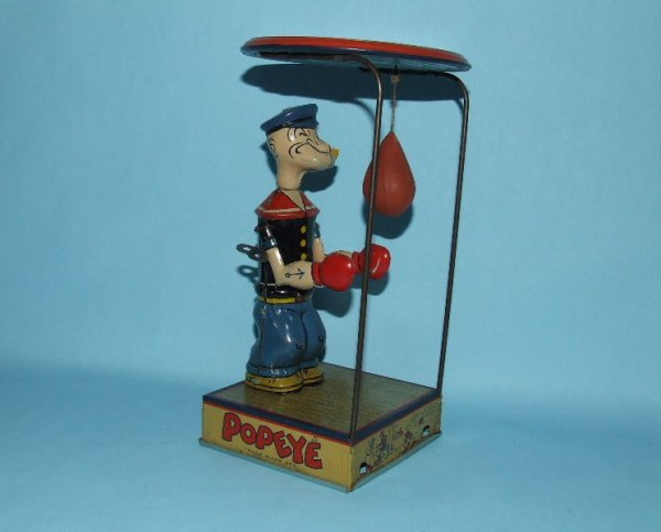 24: CHEIN POPEYE OVERHEAD PUNCHER TIN WIND UP TOY