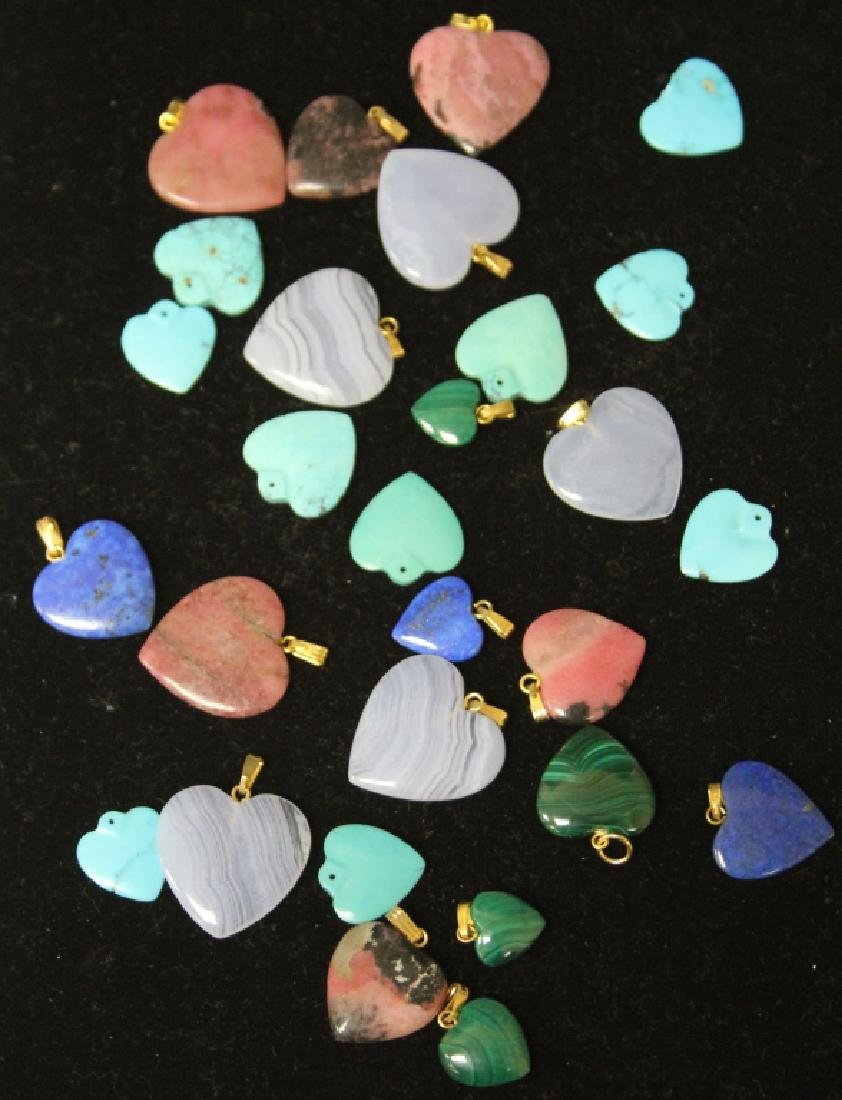 LOT OF (28) CARVED HEART PENDANTS
