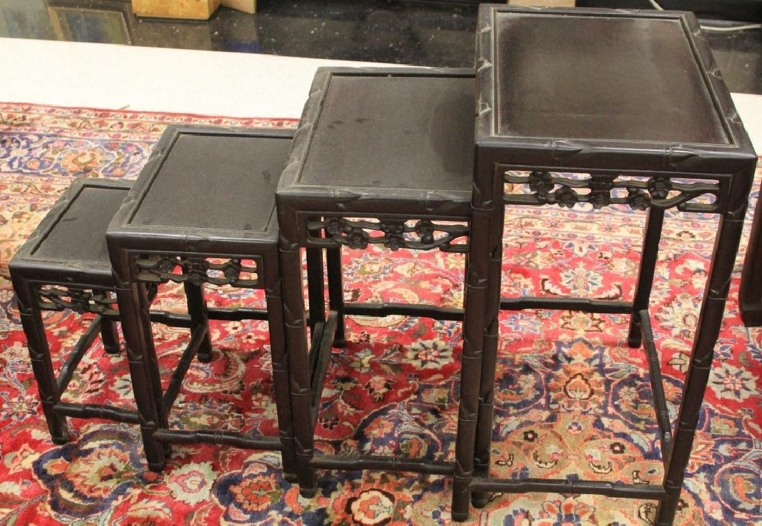 SET OF (4) VINTAGE CHINESE CARVED NESTING TABLES