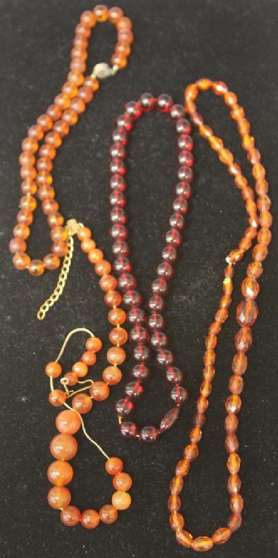 LOT OF (4) CHINESE AMBER NECKLACES