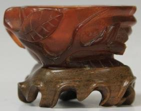 CHINESE CARVED AMBER BOWL WITH STAND