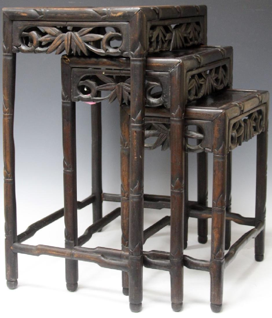 SET OF (3) CHINESE CARVED TEAK STACKING TABLES