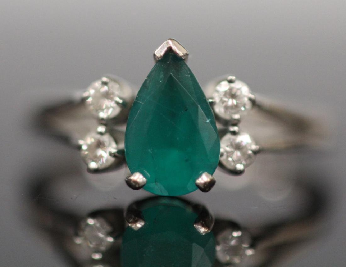 LADY'S EMERALD AND DIAMOND 18KT RING