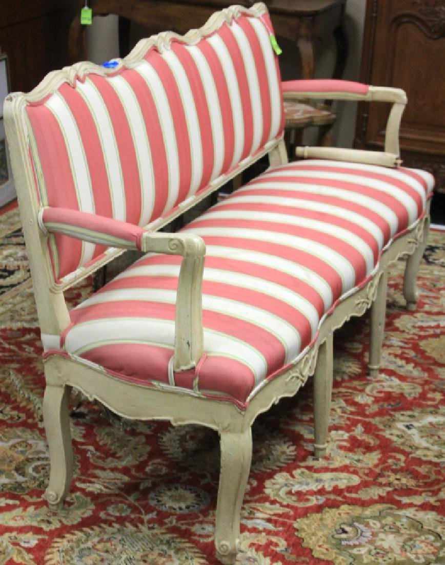 18TH C. CARVED SETTEE WITH PINK/ WHITE UPHOLS.