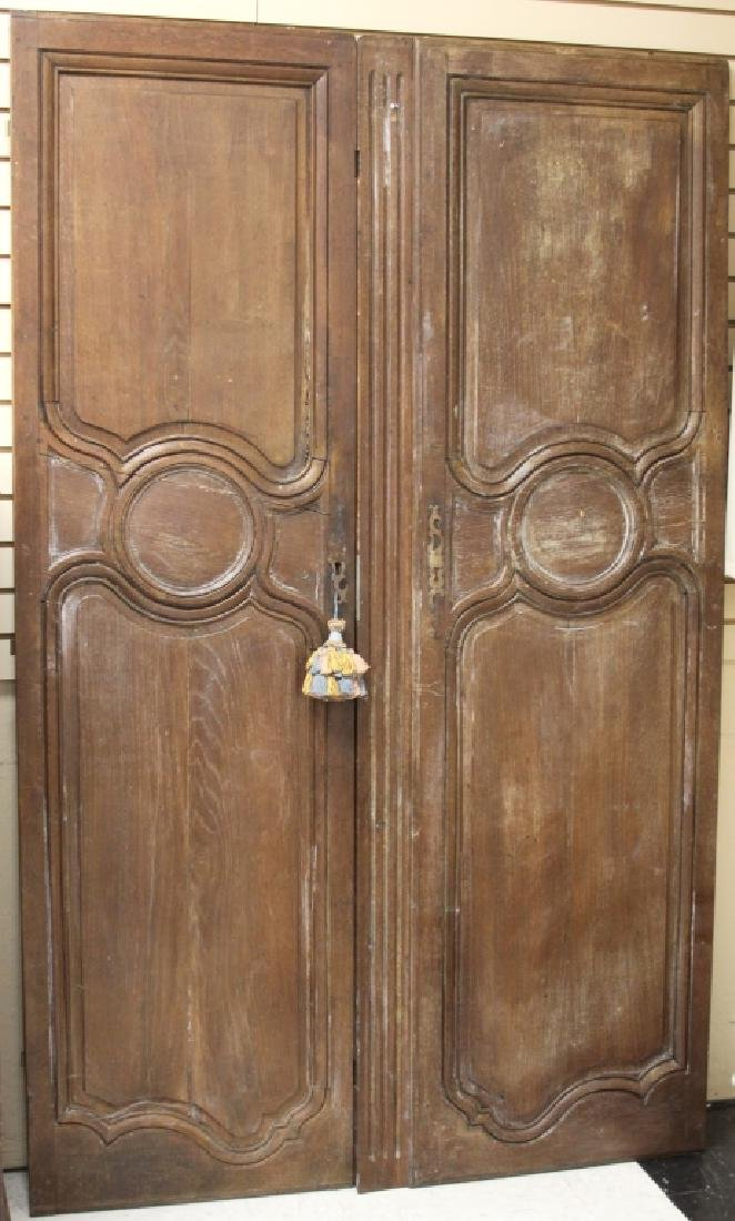 PAIR OF FRENCH PROVINCIAL WALNUT DOORS