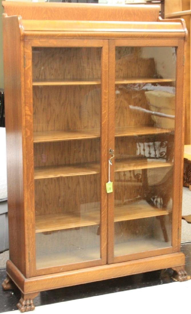 AMERICAN OAK DOUBLE DOOR BOOKCASE WITH CLAW FEET