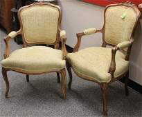 PAIR OF FRENCH CARVED WALNUT ARM CHAIRS
