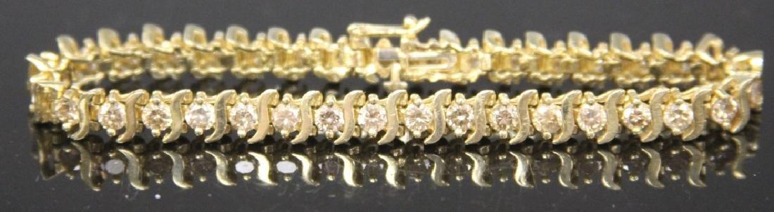 LADY'S DIAMOND 14KT GOLD TENNIS BRACELET