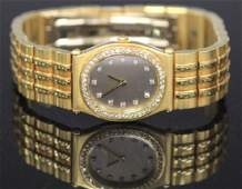 LADY'S CHOPARD GOLD WATCH W/DIAMONDS OVER/IN CASE