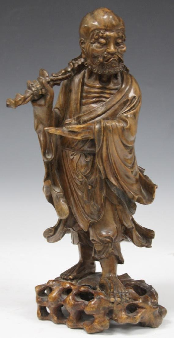 CHINESE CARVED LOHAN FIGURE WITH STAFF