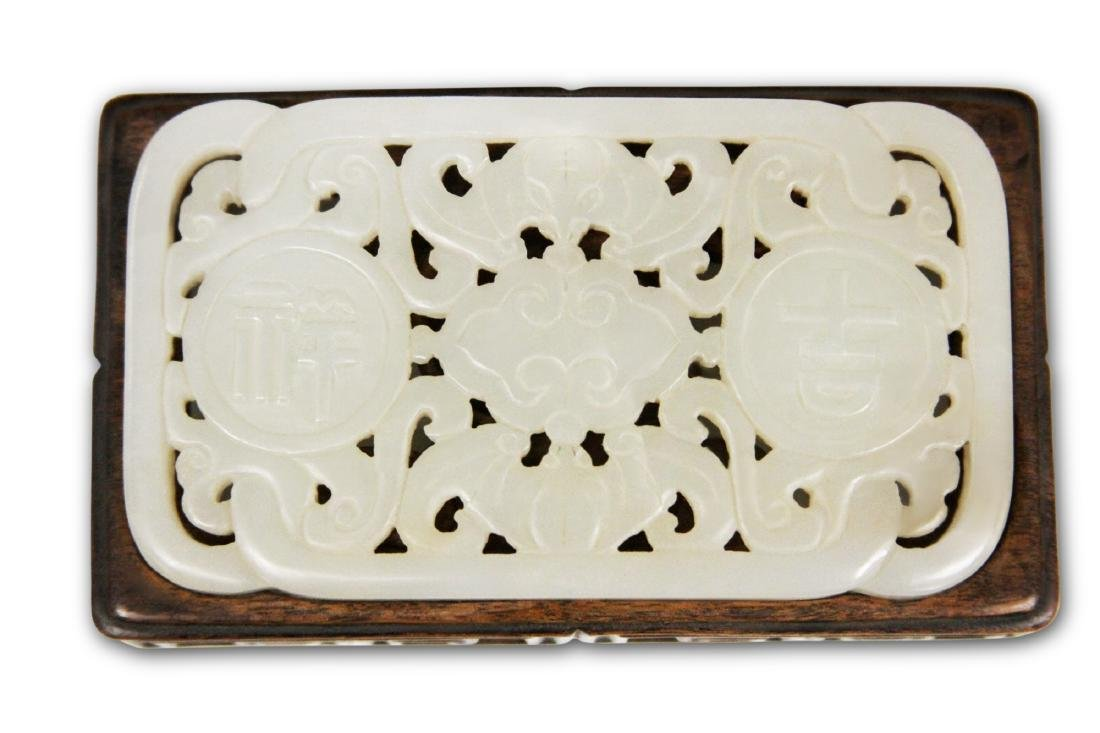 QING DYNASTY WHITE JADE BUCKLE WITH CARVED STAND