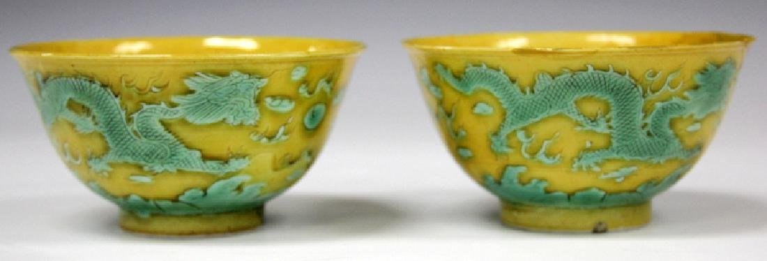 PAIR OF QING DYNASTY PORCELAIN DRAGON BOWLS