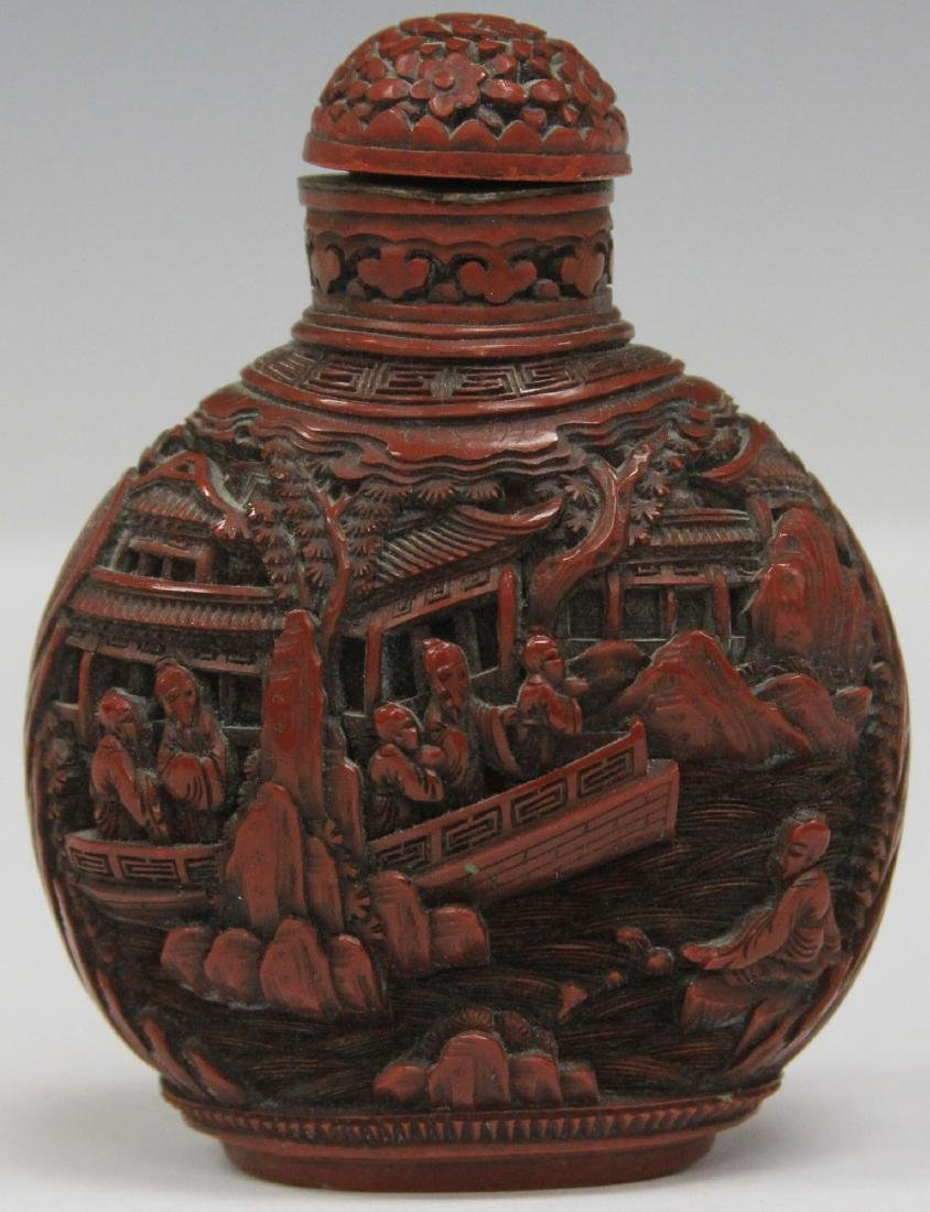 QING DYNASTY CARVED CINNABAR SNUFF BOTTLE