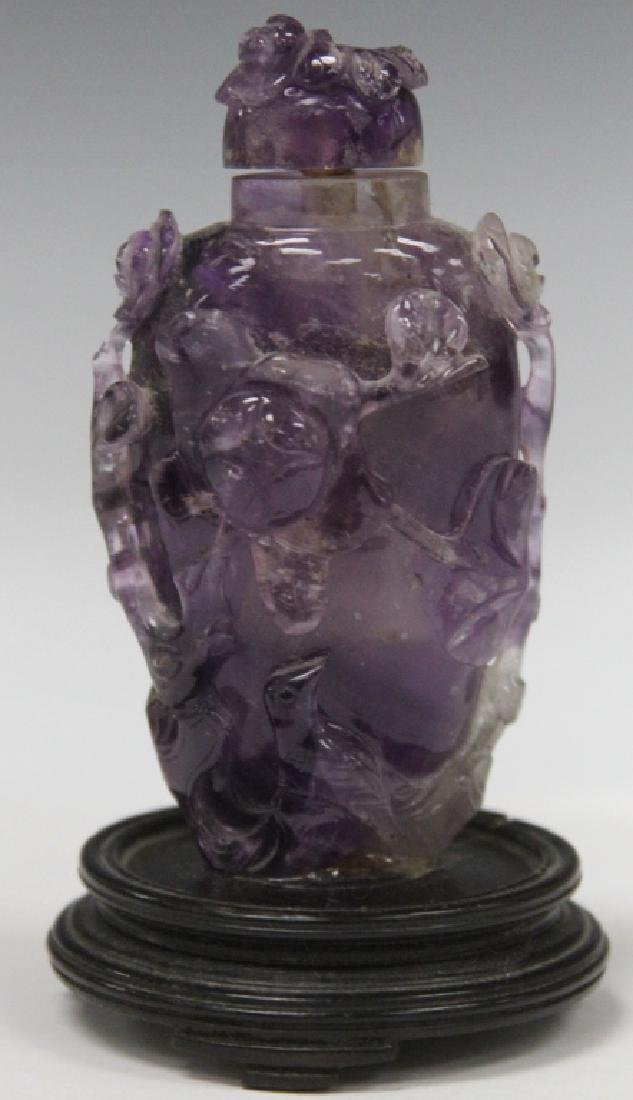 CHINESE CARVED AMETHYST SNUFF BOTTLE