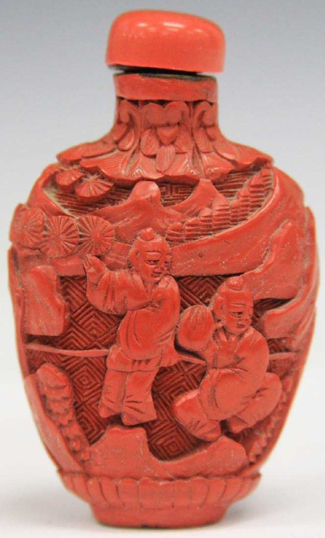 CHINESE CARVED CINNABAR SNUFF BOTTLE
