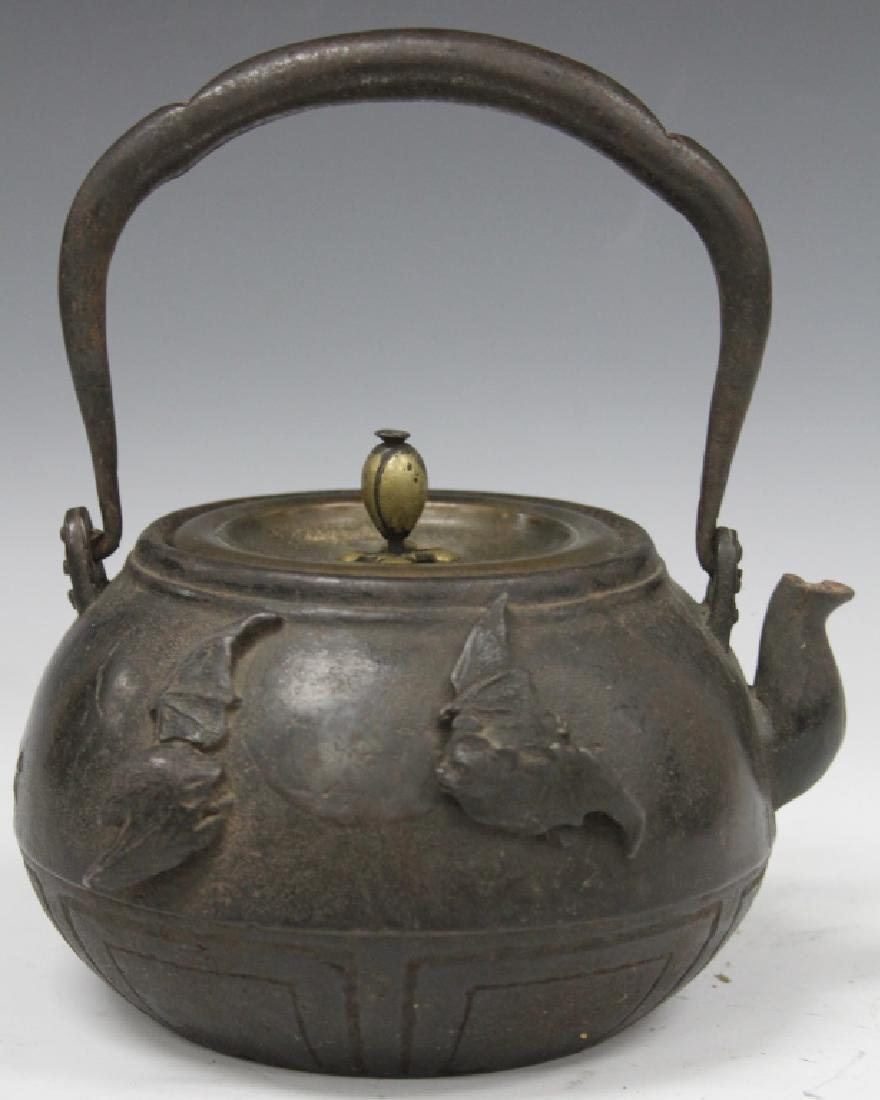 19TH C. JAPANESE IRON AND BRONZE TEA POT, SIGNED