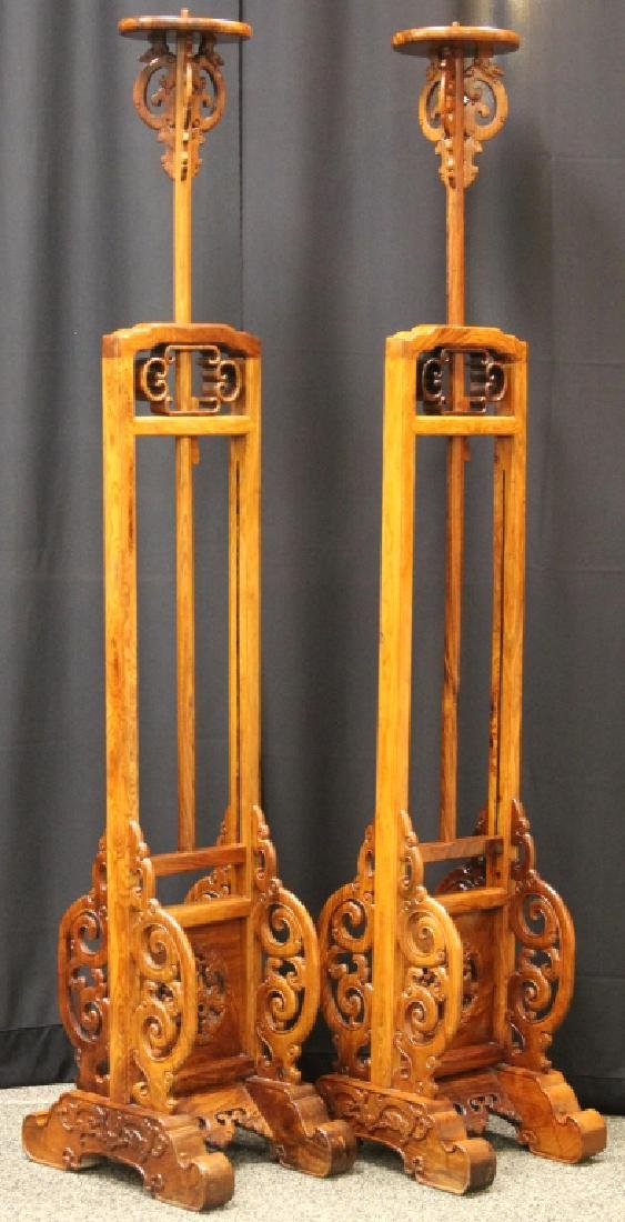 PAIR OF QING DYNASTY HUANGHUALI LAMP STANDS