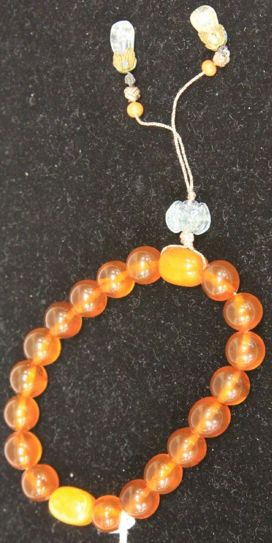 CHINESE CARVED AMBER BRACELET